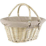 Large beige wicker basket with two handles lined with linen