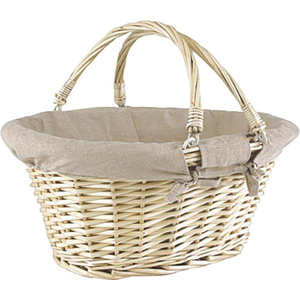 - Large beige wicker basket with two handles lined with linen