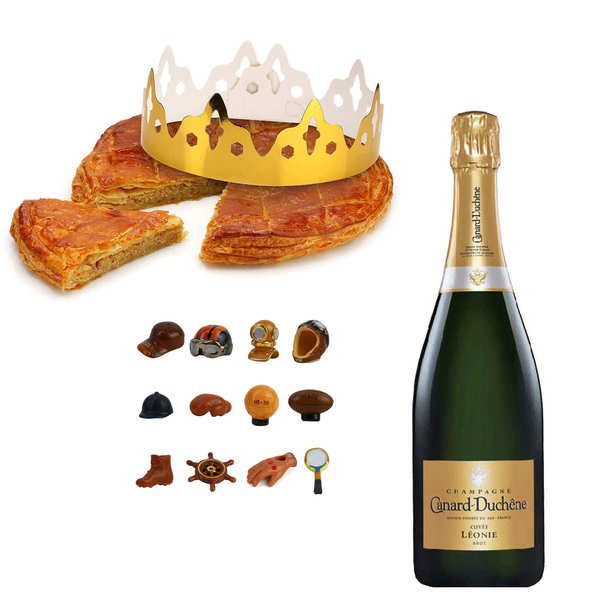 Galette des rois frangipane with a bottle of Champagne