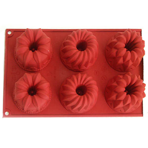 Six individual floral cake moulds